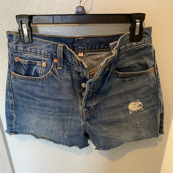 Distressed cut off jeans